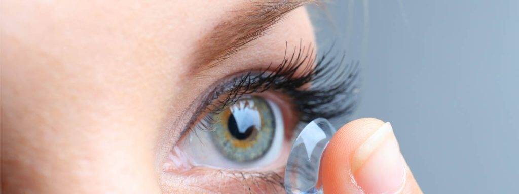 Woman inserting contact lens - Optometrist - Eye Care - Frisco, Plano & Allen, TX